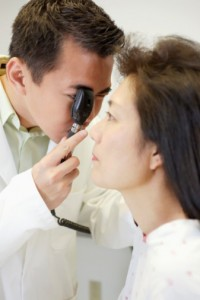 Optometrist Examining Patient s Eyes